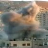 Photo - This image taken from video obtained from Ugarit, which has been authenticated based on its contents and other AP reporting, shows an explosion during heavy fighting between rebels and Syrian government forces in the Barzeh district of Damascus, Syria, Friday, April 26, 2013. On the streets of Damascus, the two-year old conflict dragged on Friday, with government troops pushing into two northern neighborhoods, triggering heavy fighting with rebels as they tried to advance under air and artillery support, activists said. The Britain-based Syrian Observatory for Human Rights said the fighting between rebels and soldiers backed by pro-government militiamen was concentrated in the Jobar and Barzeh areas.(AP Photo/Ugarit via AP video)