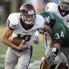 Edmond Memorial\'s Gavin Fouts gets by Conner Bays during the high school football game between Edmond Santa Fe and Edmond Memorial at Wantland Stadium in Edmond, Okla., Friday, Sept. 2, 2011. Photo by Sarah Phipps, The Oklahoman