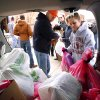 Casey Foster and Lindsey Lightner unload sacks as volunteers with CrossPoint Church deliver Valentine\'s Day gifts to homeless at Food and Shelter for Friends in Norman, Okla. on Saturday, Feb. 14, 2009. Photo by Steve Sisney, The Oklahoman