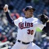 Photo - Minnesota Twins starting pitcher Kevin Correia throws against the Miami Marlins in the first inning of the first baseball game of a day/night doubleheader Tuesday, April 23, 2013 in Minneapolis. (AP Photo/Jim Mone)