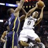 San Antonio Spurs\' Tony Parker (9), of France, looks to pass as Indiana Pacers\' Sam Young, left, defends during the third quarter of an NBA basketball game, Monday, Nov. 5, 2012, in San Antonio. (AP Photo/Eric Gay)