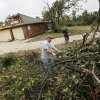 Dustin Moss, left, and Rory Farmer cut up trees to remove in the Dripping Springs Estates Saturday, May 15, 2010. Saturday hundreds of volunteers went into areas that had been affected by last week\'s tornadoes to help clear debris. Photo by Doug Hoke, The Oklahoman.