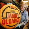 Sherry Massey, senior registrar Oklahoma History Center, looks at Jamie Oldaker\'s drum head in Oklahoma City, Monday March 11, 2013. A Tulsa native, Oldaker played with Eric Clapton from 1974-80 and 1983-86. Photo By Steve Gooch, The Oklahoman