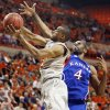 OSU\'s Markel Brown (22) moves to the hoop as KU\'s Justin Wesley (4) defends during a men\'s college basketball game between the Oklahoma State University Cowboys and the University of Kansas Jayhawks at Gallagher-Iba Arena in Stillwater, Okla., Monday, Feb. 27, 2012. Photo by Nate Billings, The Oklahoman