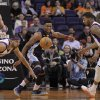 Memphis Grizzlies\' Rudy Gay, center, loses the ball as Phoenix Suns\' Jared Dudley, left, and Markieff Morris pursue during the second half of an NBA basketball game on Wednesday, Dec. 12, 2012, in Phoenix. (AP Photo/Matt York)