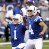 Photo -   Indianapolis Colts' Adam Vinatieri (4) and Pat McAfee (1) react after Vinatieri kicked a 53-yard game winning field goal during the second half of an NFL football game against the Minnesota Vikings in Indianapolis, Sunday, Sept. 16, 2012. The Colts won 23-20. (AP Photo/AJ Mast)