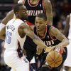Charlotte Bobcats\' Kemba Walker (15) steals the ball from Portland Trail Blazers\' Damian Lillard, right, during the first half of an NBA basketball game in Charlotte, N.C., Monday, Dec. 3, 2012. (AP Photo/Chuck Burton)