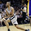 San Antonio Spurs\' Tony Parker, of France, reacts after a play during the second half of Game 1 of their first-round NBA basketball playoff series against the Los Angeles Lakers, Sunday, April 21, 2013, in San Antonio. San Antonio won 91-79. (AP Photo/Eric Gay)