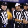 Photo -   Referee Jim Core, center, gestures alongside other game officials before an NFL football game between the New York Giants and the Dallas Cowboys, Wednesday, Sept. 5, 2012, in East Rutherford, N.J. (AP Photo/Julio Cortez)