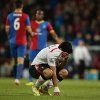 Photo - Liverpool's Luis Suarez, holds his shirt to his face following the end of the English Premier League soccer match between Crystal Palace and Liverpool at Selhurst Park stadium in London, Monday, May 5, 2014. The game ended in a 3-3 draw. (AP Photo/Alastair Grant)