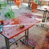 In this photo released by the Syrian official news agency SANA, plastic tables and chairs turned upside down, are seen on the floor of the open-air cafeteria at Damascus University in the central Baramkeh district, in Damascus, Syria, Thursday, March 28, 2013. Mortar shells slammed into a cafeteria at Damascus University, killing several people and wounding scores, according to state media and an official. It was the deadliest in a string of such attacks on President Bashar Assad\'s seat of power, state media and an official said. (AP Photo/SANA)