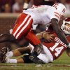 Oklahoma\'s Sam Bradford (14) hits the ground in front of Nebraska\'s Larry Asante 94) during the first half of the college football game between the University of Oklahoma Sooners (OU) and the University of Nebraska Huskers (NU) at the Gaylord Family Memorial Stadium, on Saturday, Nov. 1, 2008, in Norman, Okla. BY STEVE SISNEY, THE OKLAHOMAN