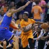 Photo - New York Knicks' Tyson Chandler, left, defends against Phoenix Suns' Eric Bledsoe, right, during the first half of an NBA basketball game, Friday, March 28, 2014, in Phoenix (AP Photo/Matt York)