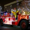 A lighted fire truck drives down the street during the Edmond Electric Parade of Lights in downtown Edmond, Okla., Saturday, Dec. 8, 2012. Photo by Bryan Terry, The Oklahoman