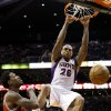Phoenix Suns\' Shannon Brown (26) dunks in front of Milwaukee Bucks\' Larry Sanders, left, in the second half during an NBA basketball game on Thursday, Jan. 17, 2013, in Phoenix. The Bucks defeated the Suns 98-94. (AP Photo/Ross D. Franklin)