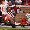 Oklahoma\'s Chris Brown (29) is pulled down by Nebraska\'s Eric Hagg (28) during the first half of the college football game between the University of Oklahoma Sooners (OU) and the University of Nebraska Huskers (NU) at the Gaylord Family-Oklahoma Memorial Stadium, on Saturday, Nov. 1, 2008, in Norman, Okla. BY NATE BILLINGS, THE OKLAHOMAN