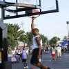 Chris White dunks on his opponent during the Red Bull King of the Rock 1-on-1 basketball tournament at The Cage in downtown Oklahoma City Saturday, July 12, 2014. Photo by Doug Hoke, The Oklahoman