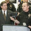 Photo - CHRISTMAS SHOPPING ALERT / WARNING: Attorney General Drew Edmondson and Oklahoma County Sheriff John Whetsel warn holiday shoppers to protect themselves against financial fraud and old-fashioned theft during a press conference in Oklahoma City, Okla. November 25, 2008. Sheriff  Whetsel is holding a fanny pack and suggested women wear the packs instead of carrying a purse.   BY STEVE GOOCH, THE  OKLAHOMAN.  ORG XMIT: KOD
