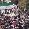 In this image made from amateur video released by Ugarit News and accessed Thursday, April 26, 2012, Syrians chant slogans during a demonstration in Hama, Syria. Syrian state media said Thursday that anti-regime bomb-makers accidentally set off blasts a day earlier that flattened parts of a residential area in the central city of Hama and killed several people. (AP Photo/Ugarit News via AP video) TV OUT, THE ASSOCIATED PRESS CANNOT INDEPENDENTLY VERIFY THE CONTENT, DATE, LOCATION OR AUTHENTICITY OF THIS MATERIAL