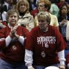 Stunned fans remain in the stands after the University of Oklahoma is defeated by Louisville 61-59 at the 2009 NCAA women\'s basketball tournament Final Four in the Scottrade Center in Saint Louis, Missouri on Sunday, April 5, 2009. Photo by Steve Sisney, The Oklahoman