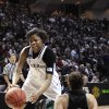 Photo - Texas A&M 's Courtney Williams (1) knocks over North Dakota's Mia Loyd (2) in the first half of a first-round NCAA women's basketball game Sunday, March 23, 2014, in College Station, Texas. The winner will face James Madison in the second round Tuesday night. (AP Photo/Pat Sullivan)