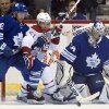Toronto Maple Leafs goaltender James Reimer gets hit in the head as center Nazem Kadri (43) tries to hold off Montreal Canadiens center David Desharnais (51) during the second period of an NHL hockey game in Toronto on Saturday, April 27, 2013. (AP Photo/The Canadian Press, Frank Gunn)