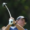 Photo - Phil Mickelson of the US plays a shot off the 5th tee during the second day of the British Open Golf championship at the Royal Liverpool golf club, Hoylake, England, Friday July 18, 2014. (AP Photo/Scott Heppell)