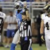 Photo -   Line judge Shannon Eastin signals second down in front of Detroit Lions wide receiver Calvin Johnson (81) and St. Louis Rams strong safety Craig Dahl (43) during the second quarter of an NFL football game, Sunday, Sept. 9, 2012 in Detroit. (AP Photo/Duane Burleson)