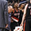 Portland Trail Blazers\' Ronnie Price (24) grimaces as he is helped off the court after an injury in the second half of an NBA preseason basketball game against the Phoenix Suns Friday, Oct. 12, 2012, in Phoenix. The Suns defeated the Trail Blazers 104-93.(AP Photo/Ross D. Franklin)