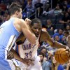 Oklahoma City\'s Kevin Durant (35) tries to get around Denver\'s Danilo Gallinari (8) during the NBA preseason basketball game between the Oklahoma City Thunder and the Denver Nuggets at the Chesapeake Energy Arena, Sunday, Oct. 21, 2012. Photo by Sarah Phipps, The Oklahoman