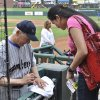Mark Harmon signs an autograph for Shiela Kilpatrick, of Enid, during the 14th Mark Harmon Celebrity Weekend at the Chickasaw Bricktown Ballpark. Photo by M. Tim Blake, for The Oklahoman M. Tim Blake