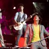 Photo - The Jonas Brothers, Nick, at left, Kevin, and Joe, perform at the Ford Center in Oklahoma City, Tuesday, July 8, 2008. BY BRYAN TERRY, THE OKLAHOMAN