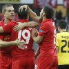 Photo -   Liverpool's Jordan Henderson, Stewart Downing and Daniel Pacheco, from left, celebrate after scoring the opening goal during the UEFA Europa League Group A soccer match between BSC Young Boys Bern and Liverpool FC at the Stade de Suisse in Bern, Switzerland, Thursday, September 20, 2012. (AP Photo/Peter Klaunzer/Keystone)