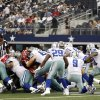 Dallas Cowboys quarterback Tony Romo (9) takes a knee in a victory formation against the Tampa Bay Buccaneers during the finals seconds of an NFL football game on Sunday, Sept. 23, 2012, in Arlington, Texas. The Cowboys won 16-10. (AP Photo/LM Otero)