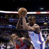 Oklahoma City\'s Serge Ibaka (9) is fouled by Portland\'s Eric Maynor (6) during the NBA basketball game between the Oklahoma City Thunder and the Portland Trail Blazers at the Chesapeake Energy Arena in Oklahoma City, Sunday, March, 24, 2013. Photo by Sarah Phipps, The Oklahoman