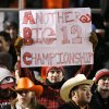 An Oklahoma fan holds up a sign during OU\'s 61-41 win over OSU during the second half of the college football game between the University of Oklahoma Sooners (OU) and Oklahoma State University Cowboys (OSU) at Boone Pickens Stadium on Saturday, Nov. 29, 2008, in Stillwater, Okla. STAFF PHOTO BY CHRIS LANDSBERGER