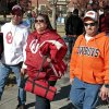 All in the family--John Johnson and his sister-in-law Tonja (left) are OU fans but Tonja\'s husband Vic roots for the opporition as they head toward the Bedlam college football game between the University of Oklahoma Sooners (OU) and the Oklahoma State University Cowboys (OSU) at Gaylord Family-Oklahoma Memorial Stadium in Norman, Okla., Saturday, Nov. 24, 2012. Photo by Steve Sisney, The Oklahoman