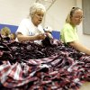 Photo - Peggy Mauldin, left, and Stephanie Lambert search look through clothes at Southern Hills Baptist Church, Friday, June 21, 2013, in Oklahoma City.  Lambert's home was destroyed in the May 20 tornado. Photo by Sarah Phipps, The Oklahoman