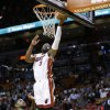 Photo - Miami Heat guard Dwyane Wade (3) shoots against Toronto Raptors forward Amir Johnson during the first half of an NBA basketball game on Wednesday, Jan. 23, 2013, in Miami. (AP Photo/Wilfredo Lee)