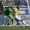 Photo - Colombia's Pablo Armero, right, kicks the ball at Greece's goalkeeper Orestis Karnezis to score his side's first goal during the group C World Cup soccer match between Colombia and Greece at the Mineirao Stadium in Belo Horizonte, Brazil, Saturday, June 14, 2014. (AP Photo/Fernando Vergara)