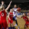 Millwood\'s Teanna Reid goes to the basket between Prague\'s Whitney Stotler, left, Alex Tilton, and Ellie Schultz, at right, during the Class 3A girls high school state basketball championship game at State Fair Arena in Oklahoma City, Saturday, March 10, 2012. Photo by Bryan Terry, The Oklahoman