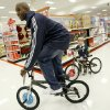 NBA BASKETBALL TEAM / CHARITY / CHRISTMAS: Joe Smith of the Oklahoma City Thunder rides a bike beside Cody Franks, 7, during a shopping spree at Target in Oklahoma City, Tuesday, Dec. 9, 2008. BY BRYAN TERRY, THE OKLAHOMAN ORG XMIT: KOD