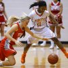 Photo - Carl Albert's Asher Sutterfield, left, and Putnam City's Jamee Moore go for the ball during their girls high school basketball game at Carl ALbert in Midwest City, Okla., Friday, Jan. 25, 2013. Photo by Bryan Terry, The Oklahoman