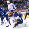 Photo - Toronto Maple Leafs goalie Jonathan Bernier (45) blocks a shot by New York Islanders forward Brock Nelson (29 as Maple Leafs defenceman Dion Phaneuf (3) looks on during first period of an NHL hockey game in Toronto, Tuesday, Jan. 7, 2014. (AP Photo/The Canadian Press, Nathan Denette)