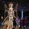 CHILD / KIDS: Children play around a lighted angel during the Mayor\'s Tree Lighting at Shannon Miller Park in Edmond, Okla., Saturday, Dec. 8, 2012. Photo by Bryan Terry, The Oklahoman
