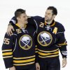 Buffalo Sabres\' Jochen Hecht (55), of Germany, celebrates with Drew Stafford (21) after an NHL hockey game against the New York Islanders\' in Buffalo, N.Y., Friday, April 26, 2013. Buffalo won, 2-1. (AP Photo/Gary Wiepert)
