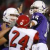 Bethany quarterback Ryley Claborn looks for an open receiver with pressure from Washington\'s Luke Hayes during their high school football game in Bethany, Okla., on Friday, September 16, 2011. Photo by John Clanton, The Oklahoman