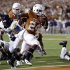 Photo -   Texas' Joe Bergeron (24) scores against West Virginia during the third quarter of an NCAA college football game on Saturday, Oct. 6, 2012, in Austin, Texas. (AP Photo/Eric Gay)