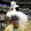 Milwaukee Brewers\' Carlos Gomez covers teammate Caleb Gindl with powder after Gindl hit a walk-off home run during the 13th inning of a baseball game against the Miami Marlins Sunday, July 21, 2013, in Milwaukee. The Brewers won 1-0. (AP Photo/Morry Gash)