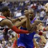 Photo - Washington Wizards guard John Wall (2) combines with center Marcin Gortat (4), from Poland, to defend Philadelphia 76ers guard James Anderson in the first half of an NBA basketball game, Friday, Nov. 1, 2013, in Washington. (AP Photo/Alex Brandon)